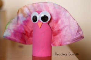 Thanksgiving turkey craft kids can make from a cardboard tube and coffee filter