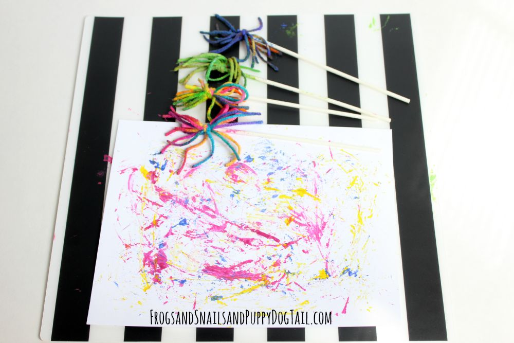 yarn paint brush paintings with kids